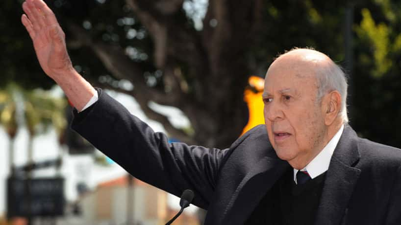 Carl Reiner waves to the crowd as he gives a speech about his associate Actor/Director Mel Brooks at the ceremony to unveil his Hollywood Walk of Fame star in Hollywood on April 23, 2010. Mel Brooks began his distinguished career during television�s Golden Age as a writer for Sid Caesar on Your Show of Shows, the first of many comedy series for which he would write. He has created a remarkable string of hit comedies: The Twelve Chairs, Blazing Saddles, Young Frankenstein, Silent Movie, High Anxiety, History of the World Part I, To Be or Not To Be, Spaceballs, Life Stinks, Robin Hood: Men in Tights and Dracula: Dead and Loving It. Like The Producers, Young Frankenstein also made a successful transition to the Broadway musical stage. AFP PHOTO/Mark RALSTON (Photo credit should read MARK RALSTON/AFP via Getty Images)