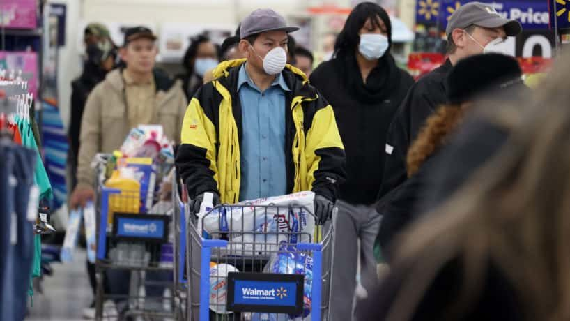 A photo of people wearing masks in public
