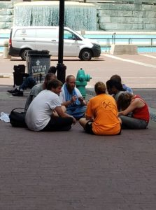 Homeless People Enjoy a Relaxing Afternoon of Heroin and Public Defecation on Monument Circle.