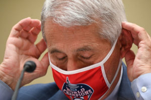 Anthony Fauci, director of the National Institute of Allergy and Infectious Diseases, wears a Washington Nationals protective mask during a House Select Subcommittee on the Coronavirus Crisis hearing on July 31, 2020 in Washington, DC. Trump administration officials are set to defend the federal government's response to the coronavirus crisis at the hearing hosted by a House panel calling for a national plan to contain the virus. (Photo by Erin Scott-Pool/Getty Images)