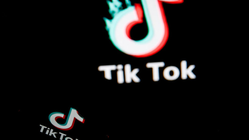 TikTok closeup logo displayed on a smartphone screen and another TikTok logo as background on a TV screen in Chania, Crete Island, Greece on August 3, 2020. President of the USA Donald Trump is threatening and planning to ban the popular video sharing app TikTok from the US because of the security risk. (Photo by Nikolas Kokovlis/NurPhoto via Getty Images)