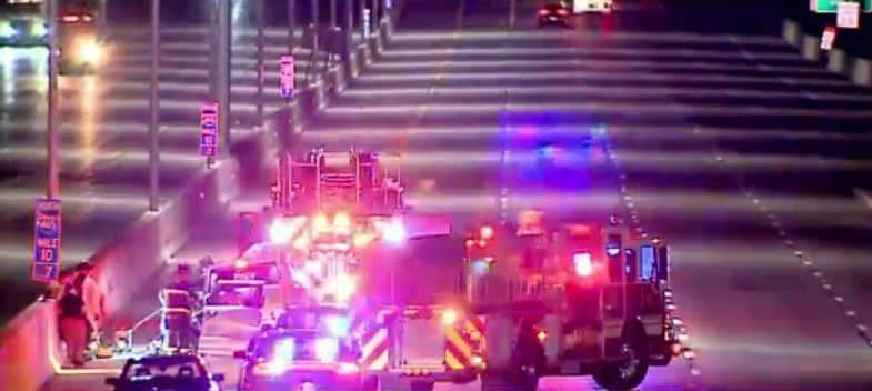 Firetrucks, police cars, and ambulances on the scene of the crash on I-465 near Sam Jones Expressway