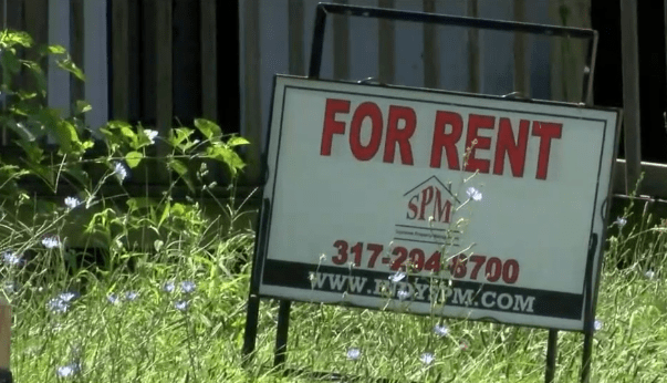 "A yard sign, ""For Rent."""