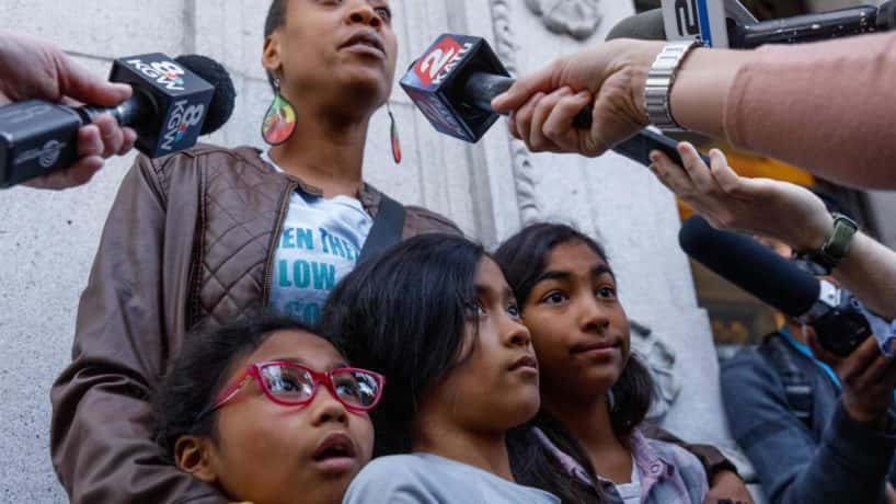 Demetria Hester, who was assaulted by Jeremy Christian the night before the murders, speaks to the media while holding her daughters outside the courthouse after Jeremy Christian was found guilty of first-degree murder on February 21, 2020 in Portland, Oregon. - Christian stabbed Ricky Best and Taliesin Namkai-Meche to death, and grievously wounded a third man in a racially-motivated attack on a Max train in Portland, Oregon in May, 2017. (Photo by John Rudoff / AFP) (Photo by JOHN RUDOFF/AFP via Getty Images)