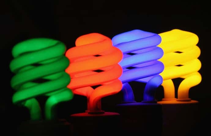 Light bulbs lit up in different colors