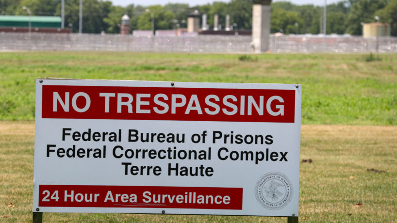 A No Trespassing sign stands in front of the federal prison complex in Terre Haute, Ind. Friday, July 17, 2020.