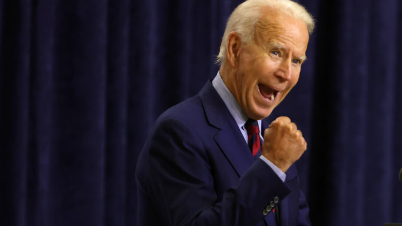 Former Vice President Joe Biden appears before a grand stage of supporters without his teeth.