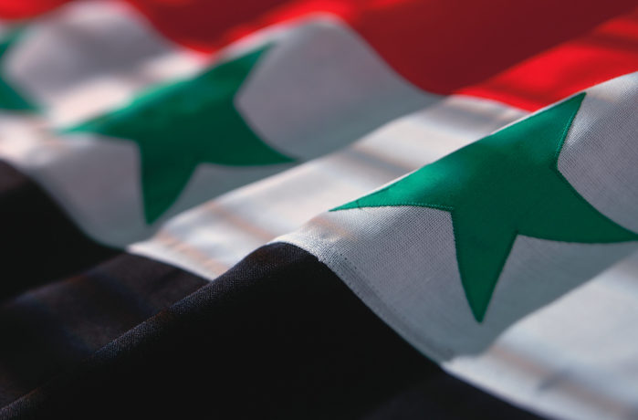 A close up of the flag of Iraq.