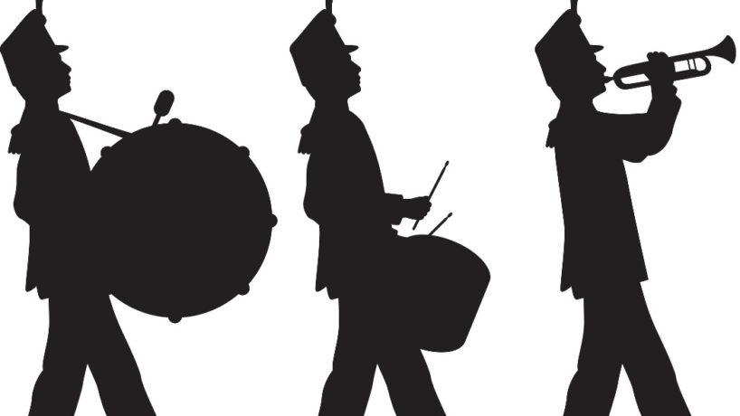 Silhouette of people in a marching band