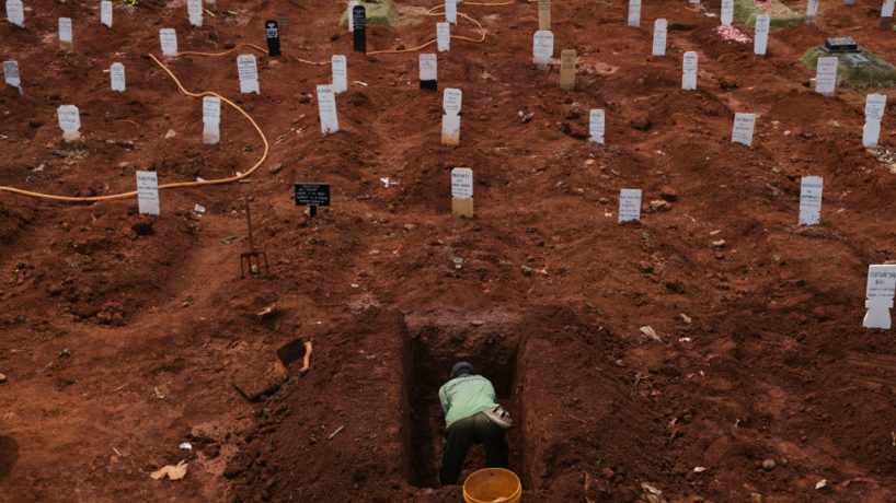 Man digging a grave in Indonesia