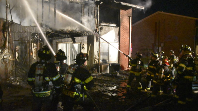 An image of firefighters putting out the fire at Greentree Apts Friday night.