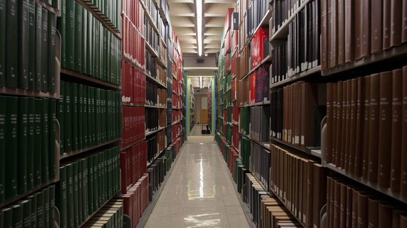 A photo of books on shelves at a library