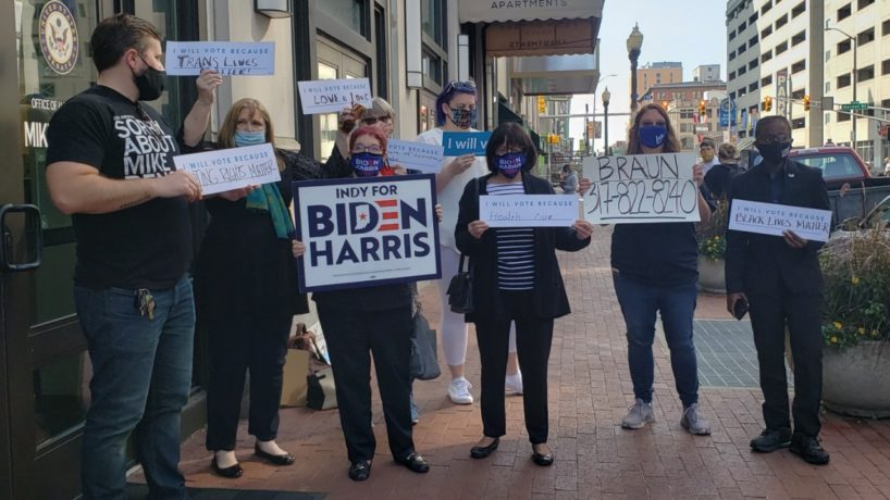 An image of the protesters in front of Sen. Mike Braun's office Monday.