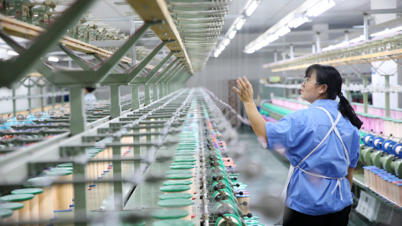 CHONGQING, CHINA - SEPTEMBER 17: An employee works on the production line at Zhejiang Huashen Silk Import and Export Co., Ltd. on September 17, 2020 in Chongqing, China.