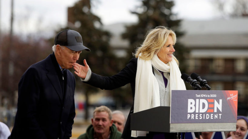 Democratic presidential candidate, former Vice President Joe Biden bites the finger of his wife Jill Biden as she introduces him during a campaign event on November 30, 2019 in Council Bluffs, Iowa. Biden, who begins his eight-day bus tour across Iowa on Saturday, once lead the state in the polls but now trails presidential candidates Pete Buttigieg and Elizabeth Warren with just under 3 months until the 2020 Iowa Democratic caucuses. (Photo by Joshua Lott/Getty Images)
