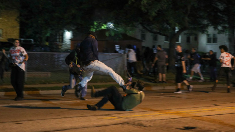 (EDITORS NOTE: Image contains graphic content.) Clashes between protesters and armed civilians, who protect the streets of Kenosha against the arson, break out during the third day of protests over the shooting of a black man Jacob Blake by police officer in Wisconsin, United States on August 25, 2020. (Photo by Tayfun Coskun/Anadolu Agency via Getty Images)