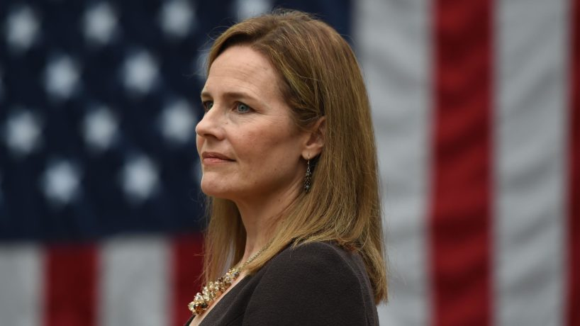 Judge Amy Coney Barrett in front of an American flag