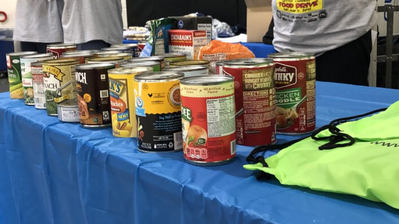 donated canned goods on table