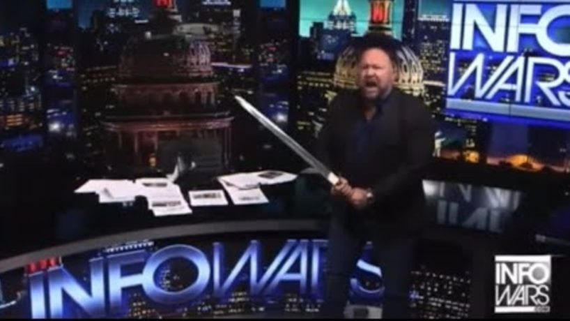 Conspiracy theorist Alex Jones slices a drone with a sword.