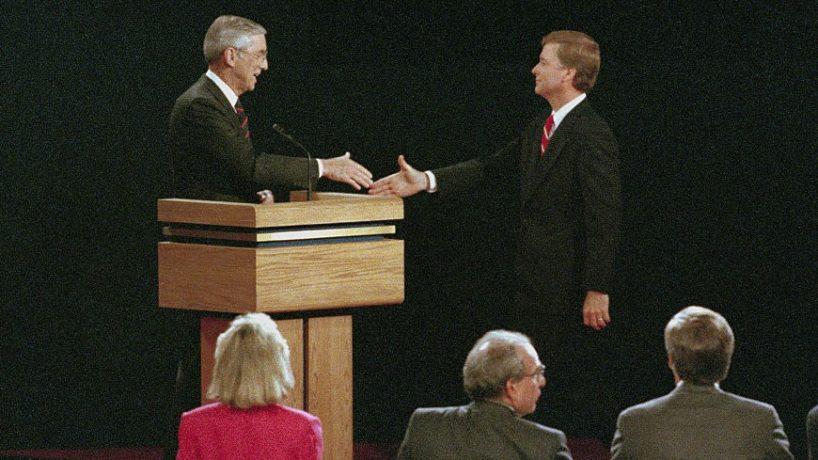 Omaha, Nebraska: Following their vice presidential debate, Senators Lloyd Bentsen (L) of Texas and Dan Quayle (R) of Indiana reach out to shake hands, October 5th.