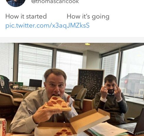 Indianapolis Mayor Joe Hogsett eats pizza while Chief Deputy Mayor Thomas Carl Cook gives the middle finger. Twice. Screenshot from Twitter.