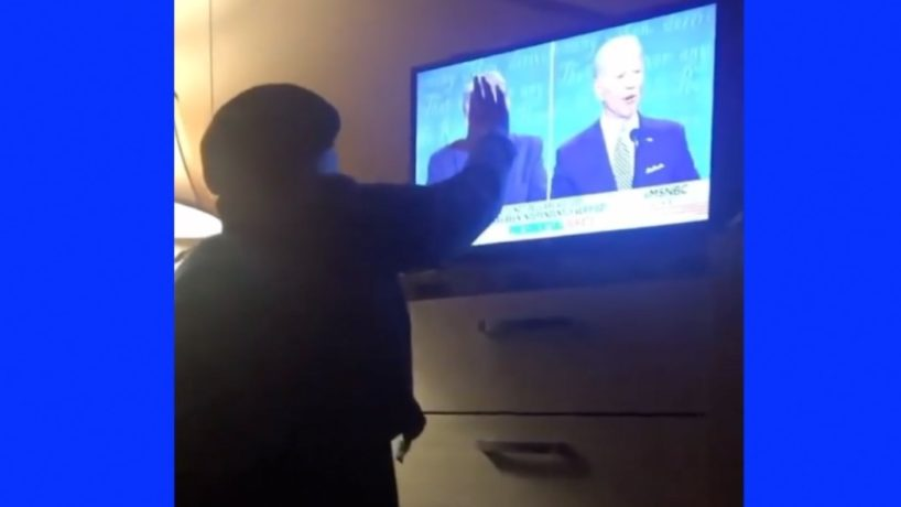 A woman pours Holy water on her television as she prays for President Trump.