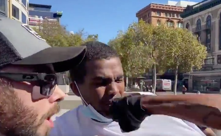 A black Trump supporter is punched in the face outside a rally in San Francisco.
