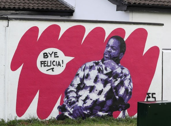 A man stops to take pictures of Irish artist Emmalene Blake's mural of rapper and actor Ice Cube from a scene in the movie 'Friday' in South Dublin. This is the latest in the 'Stay At Home' series by the Dublin artist encouraging people to stick to social distancing. Other artists featured have been Dua Lipa, Robyn and Cardi B. (Photo by Brian Lawless/PA Images via Getty Images)