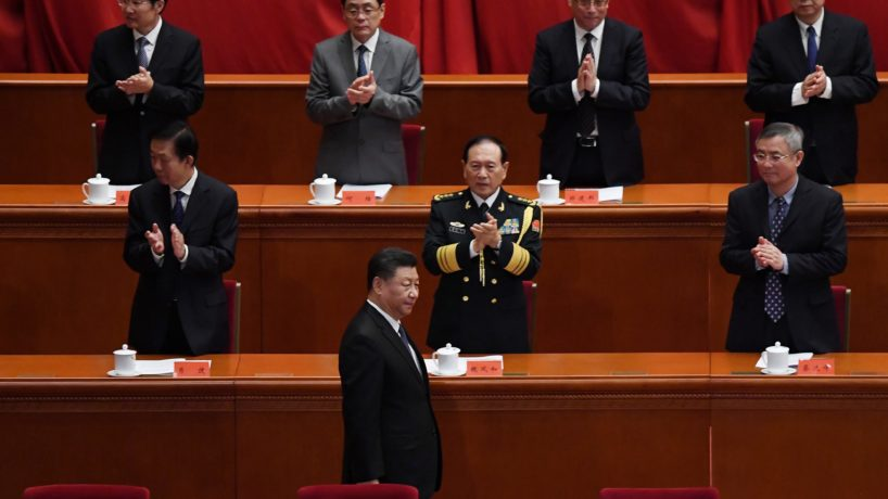 Chinese leaders clapping