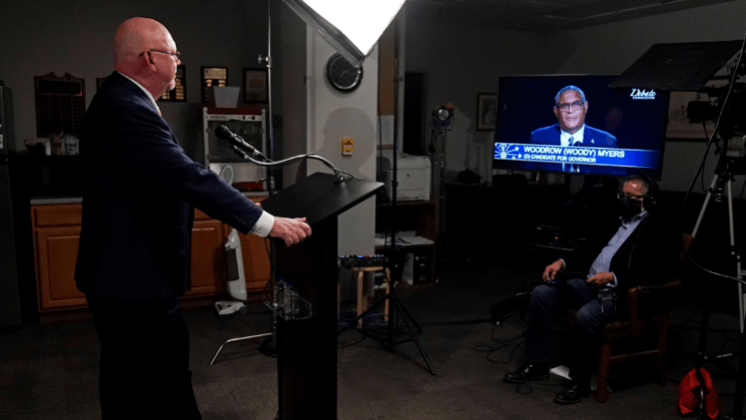 Libertarian candidate for governor Donald Rainwater faces a monitor with Democratic candidate Dr. Woody Myers on it in the second debate for governor.