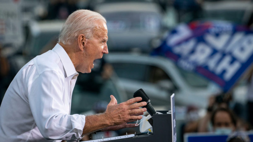 Democratic presidential nominee Joe Biden speaks during a drive-in campaign rally in the parking lot of Cellairis Ampitheatre on October 27, 2020 in Atlanta, Georgia. Biden is campaigning in Georgia on Tuesday, with scheduled stops in Atlanta and Warm Springs. (Photo by Drew Angerer/Getty Images)