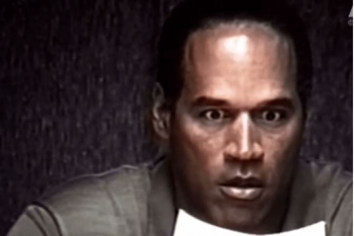 OJ Simpson Expresses Shock as He Looks at a Photograph