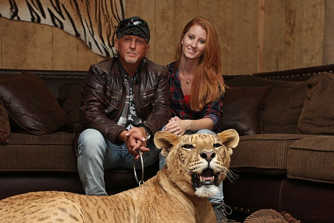 eff Lowe and Lauren Dropla with Faith the liliger at their home inside the Greater Wynnewood Exotic Animal Park on September 28, 2016 in Wynnewood, Oklahoma. ANIMAL lover Jeff Lowe provides care and shelter to more than 220 big cats - and they live in his back garden. 51-year-old Jeff owns the Greater Wynnewood Exotic Animal Park in Oklahoma, one of the largest private zoos in the world that rescues and protects over 500 wild animals, from tigers and lions to bears and crocodiles. Jeff, a multimillionaire, spends his days closely interacting with the most dangerous animals, walking them on leads inside his cabin house and laying in and around their enclosures he even takes his smaller tigers to the vets in his Ferrari. Lauren Dropla, Jeffs 25-year-old fiancé, offers a helping hand with looking after their exotic pets and maintaining the park on a daily basis. PHOTOGRAPH BY Ruaridh Connellan / Barcroft Images London-T:+44 207 033 1031 E:hello@barcroftmedia.com - New York-T:+1 212 796 2458 E:hello@barcroftusa.com - New Delhi-T:+91 11 4053 2429 E:hello@barcroftindia.com www.barcroftimages.com (Photo credit should read Ruaridh Connellan/BarcroftImages / Barcroft Media via Getty Images)