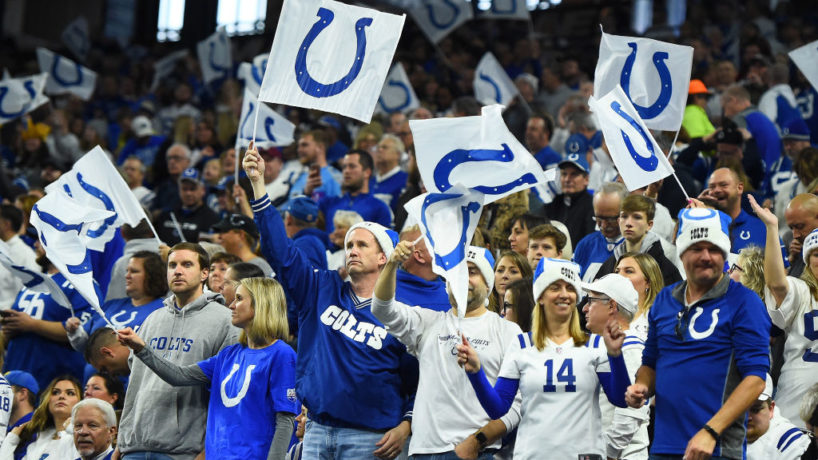 Fans of the Indianapolis Colts celebrate a touchdown against the Tennessee Titans during the first quarter at Lucas Oil Stadium on December 01, 2019 in Indianapolis, Indiana.