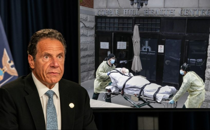 New York Gov. Andrew Cuomo sits in front of screen showing workers carrying dead person out of an elderly care facility.