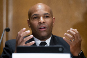 WASHINGTON - SEPTEMBER 9: US Surgeon General Jerome Adams appears before a Senate Health, Education, Labor, and Pensions Committee hearing to discuss vaccines and protecting public health during the coronavirus pandemic on September 9, 2020 in Washington DC. Dr. Anthony Fauci, director of the National Institute of Allergy and Infectious Diseases, recently said a vaccine likely won't be available until late this year at the soonest.