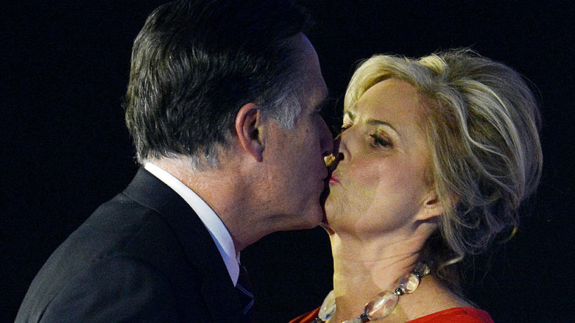 US Republican presidential candidate Mitt Romney kisses his wife Ann after conceding defeat to President Barack Obama on November 7, 2012 in Boston. Obama swept to re-election, forging history again by transcending a slow economic recovery and the high unemployment which haunted his first term to beat Romney. AFP PHOTO/Stan HONDA (Photo credit should read STAN HONDA/AFP via Getty Images)