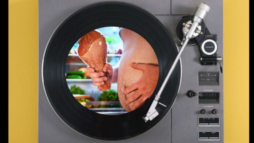 A turntable platter featuring a man with a turkey leg and a massive belly.