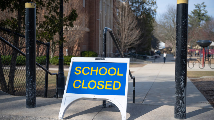 """A """"closed"""" sign in front of a public elementary school in Grand Rapids, Michigan in March 2020. Michigan closed all schools in an effort to thwart the spread of the novel coronavirus."""