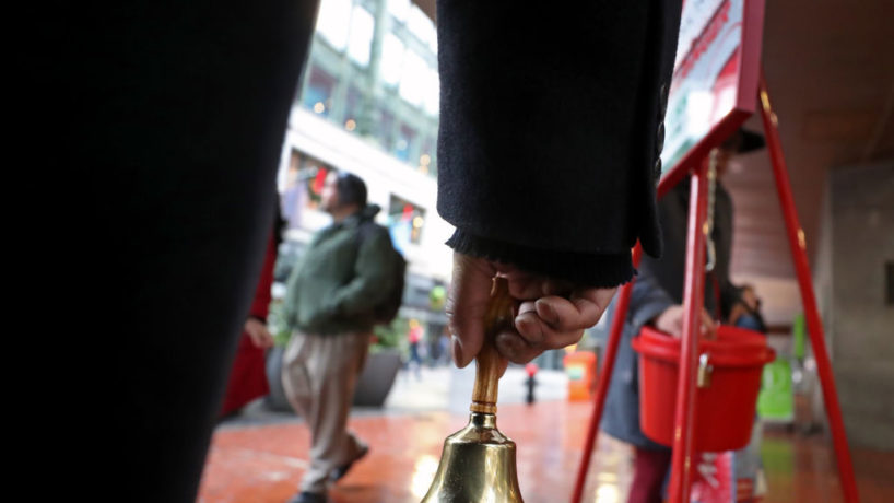 Major Elvie Carter rings the holiday bell for the Salvation Army Red Kettle event to support Salvation Army programs outside Macy's in Boston's Downtown Crossing on Dec. 9, 2019.
