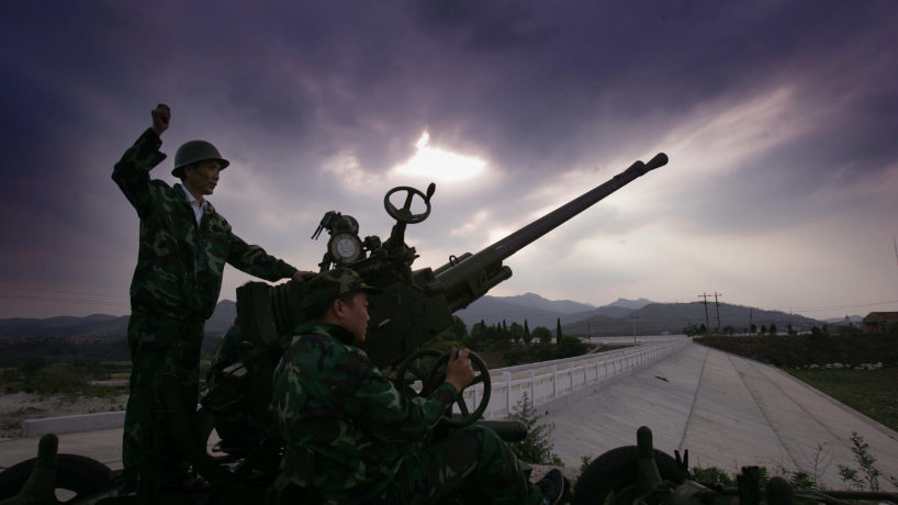 A Chinese worker fires rockets for cloud seeding