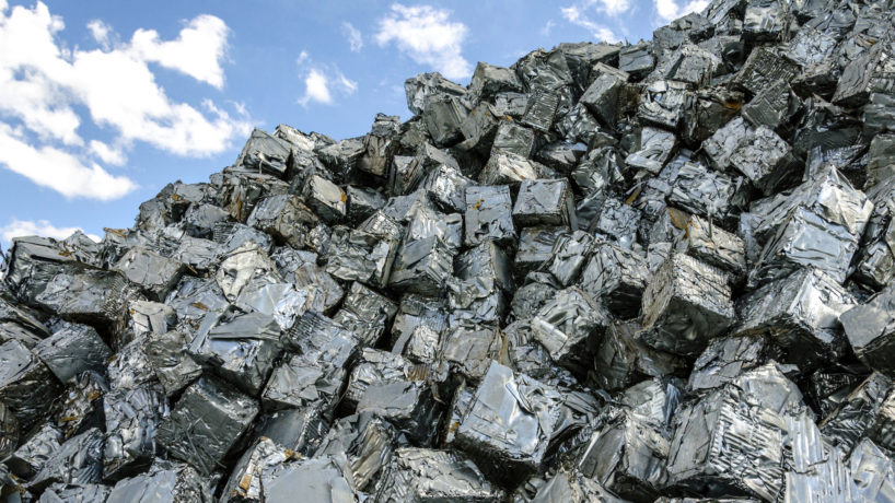 Pile of metal scrap cubes ready to be recycled.