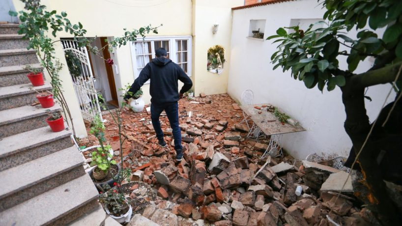 Photograph of a man walking over debris in Zagreb, the Croatian capital.