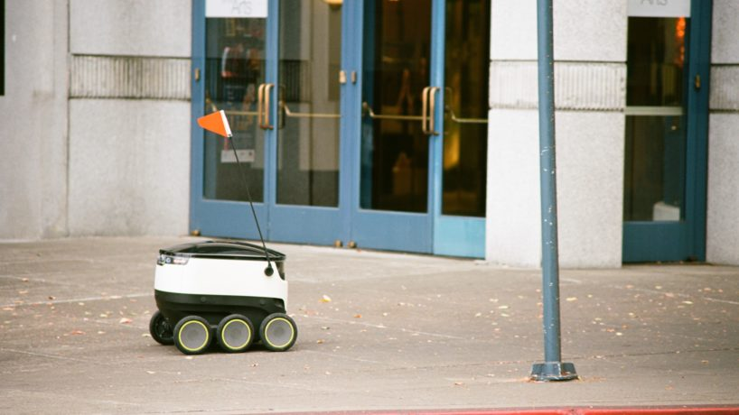 Self-driving delivery robot from startup Starship Technologies drives past the Lesher Center in downtown Walnut Creek, California, as it makes an automated delivery for a local business, August 24, 2017.