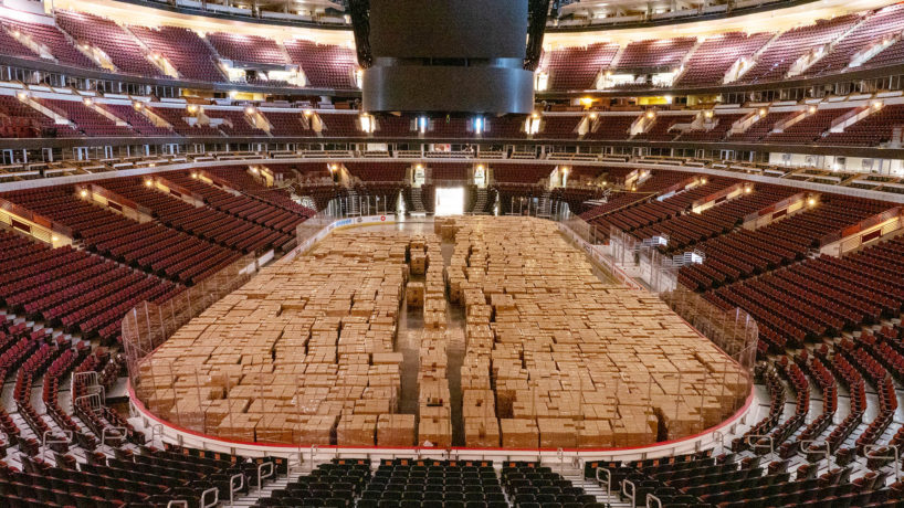 Non-perishable food items sit to be delivered on the floor fo the United Center in the wake of the Coronavirus COVID-19 pandemic, Friday, April 17, 2020, in Chicago, Illinois, United States. (Photo by Jason Whitman/NurPhoto via Getty Images)