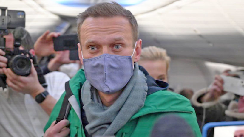 Russian opposition leader Alexei Navalny walks to take his seat in a Pobeda airlines plane heading to Moscow before take-off from Berlin Brandenburg Airport in Schoenefeld, southeast of Berlin, on January 17.
