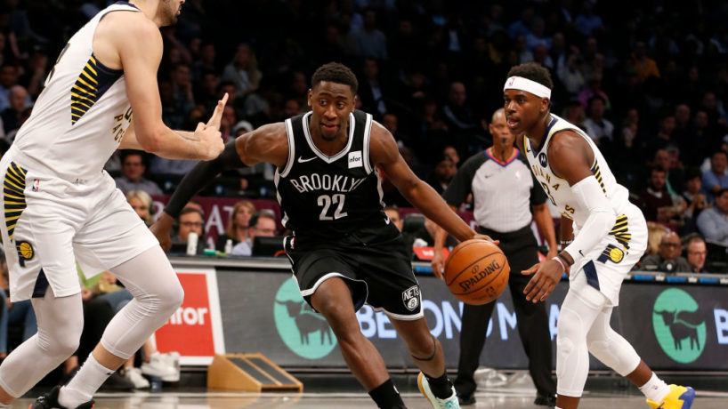 Caris LeVert playing a basketball game with the Nets