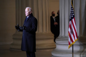 Biden at the Lincoln Memorial speaking to a camera with no mask