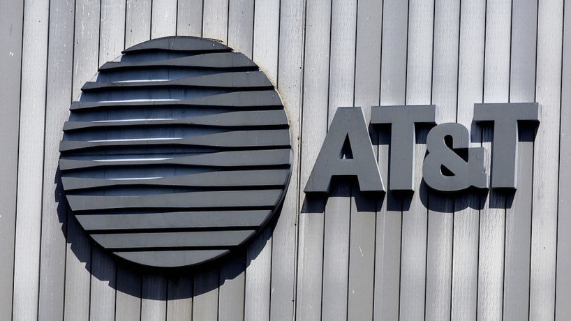 The AT&T logo and initials sit atop their building 18 August, 2006, in Arlington, Virginia.