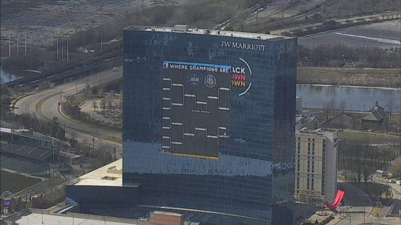 An NCAA men's basketball tournament bracket is constructed on the JW Marriott hotel is downtown Indianapolis on Feb. 25, 2021.
